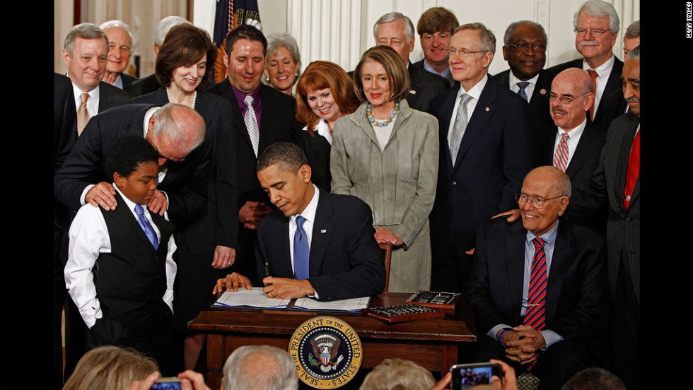 President Barack Obama signs the health care legislation in a March 23, 2010, ceremony with Democrats in the White House East Room. The law, which critics dubbed Obamacare, is Obama's signature legislation.