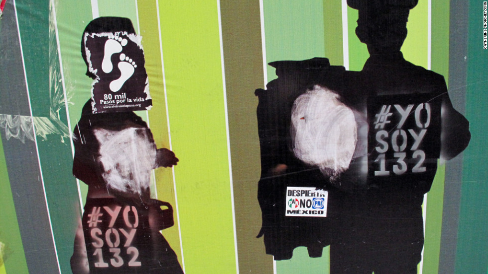 Graffiti supporting the #YoSoy132 youth protest movement covers a wall in Mexico City.