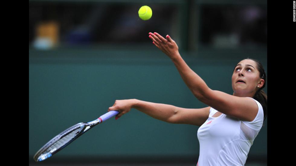 Austria's Tamira Paszek serves during her first round women's singles match against Denmark's Caroline Wozniacki on June 26.