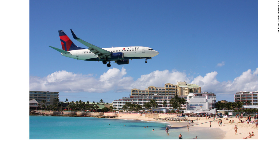 "Customers at the Sunset Bar & Grill on Maho Beach ""go crazy,"" when the big planes fly overhead, says bar employee Dianne Carbon. ""When they're taking off or coming in -- it's almost like it was an earthquake."""