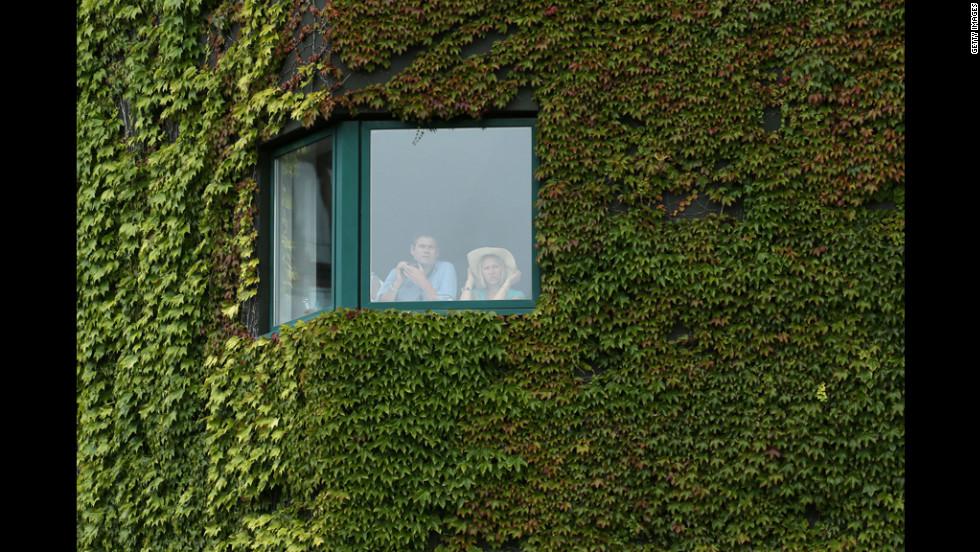 Wimbledon staff enjoy the match from indoors on June 27.