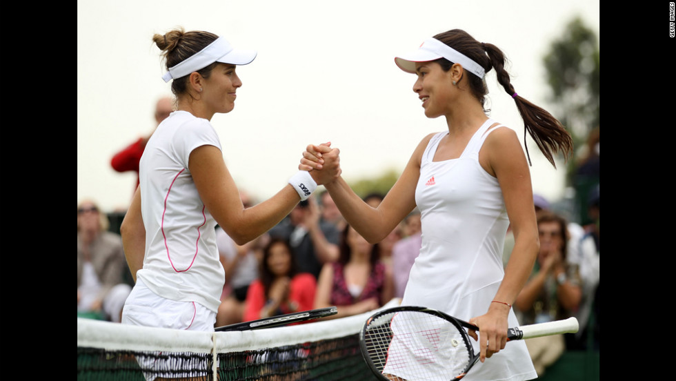 Ana Ivanovic of Serbia, right, is congratulated by Maria Jose Martinez Sanchez of Spain on Wednesday.
