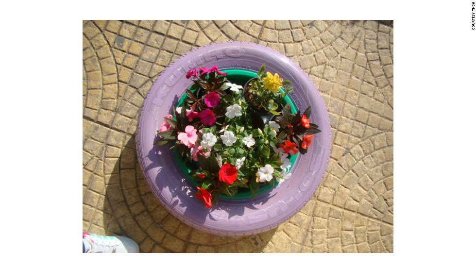 YNCA, a youth civil activism organization in Nabatieh, southern Lebanon, has been painting car tires and repurposing them as flower pots, coffee tables and book shelves around the city center.