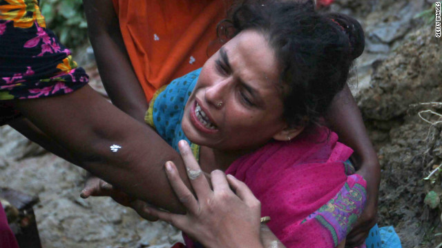 A woman mourns relatives killed in a landslide in Chittagong, Bangladesh, on Wednesday.