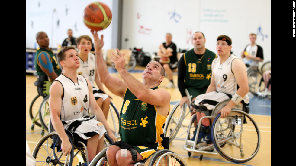 Kobus Oeschger of South Africa takes a shot against Germany's team during a wheelchair basketball game Wednesday in Erfurt, Germany.