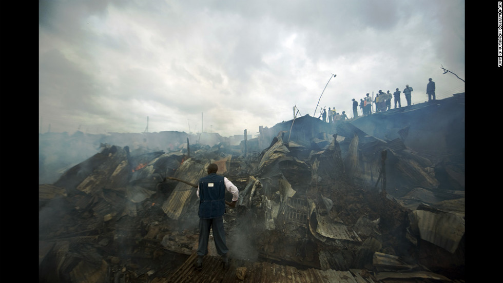 Residents of the Mathare slum in Nairobi, Kenya, try to put out a fire Wednesday that gutted at least 20 shanty homes.