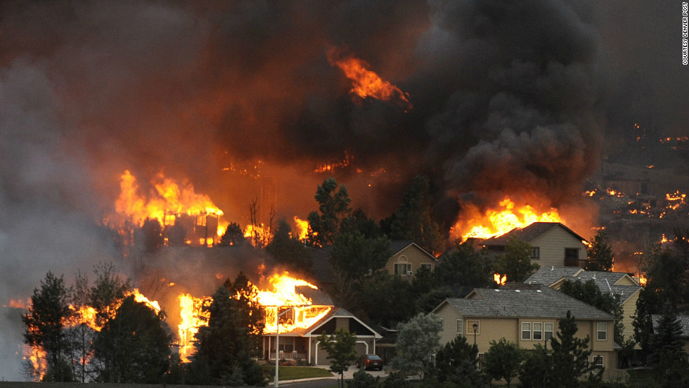 "The Waldo Canyon fire spreads through a neighborhood in the hills above Colorado Springs on June 26. See more photos at <a href=""http://www.denverpost.com/"" target=""_blank"">The Denver Post</a>."