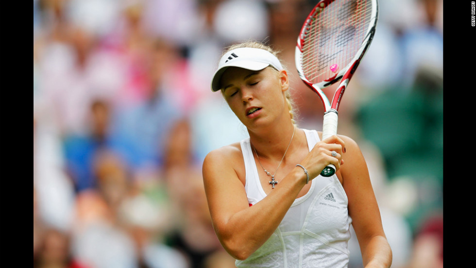 Caroline Wozniacki of Denmark reacts during her first-round match against Tamira Paszek of Austria on Wednesday.