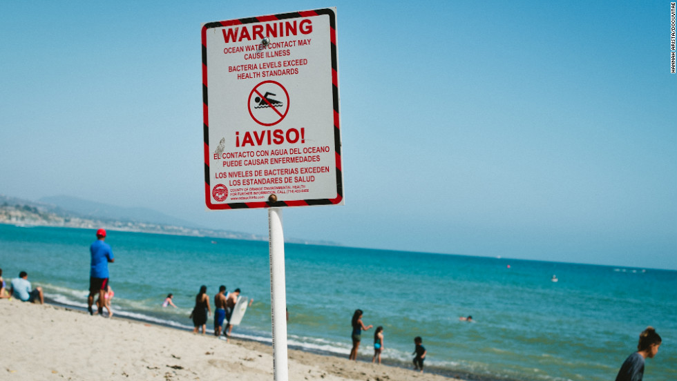"A sign warns swimmers of health dangers at <a href=""http://www.dohenystatebeach.org/"" target=""_blank"">Doheny State Beach</a> in Orange County, California. The beach was listed as a ""Repeat Offender"" in the National Resources Defense Council's ""Testing the Waters"" report. These are beaches that continually have high bacteria counts."