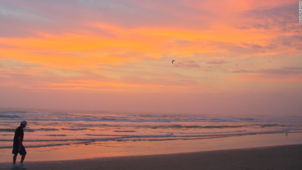 "The sun rises at <a href=""http://www.sopadre.com/island/"" target=""_blank"">South Padre Island Beach</a> in Cameron County, Texas. The beach received the five-star status from the council based on 2011 data collected from test results at 3,000-plus beaches nationwide."