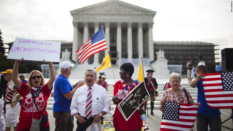 Protesters against the health care law rally outside the Supreme Court before the justices issue their ruling Thursday.