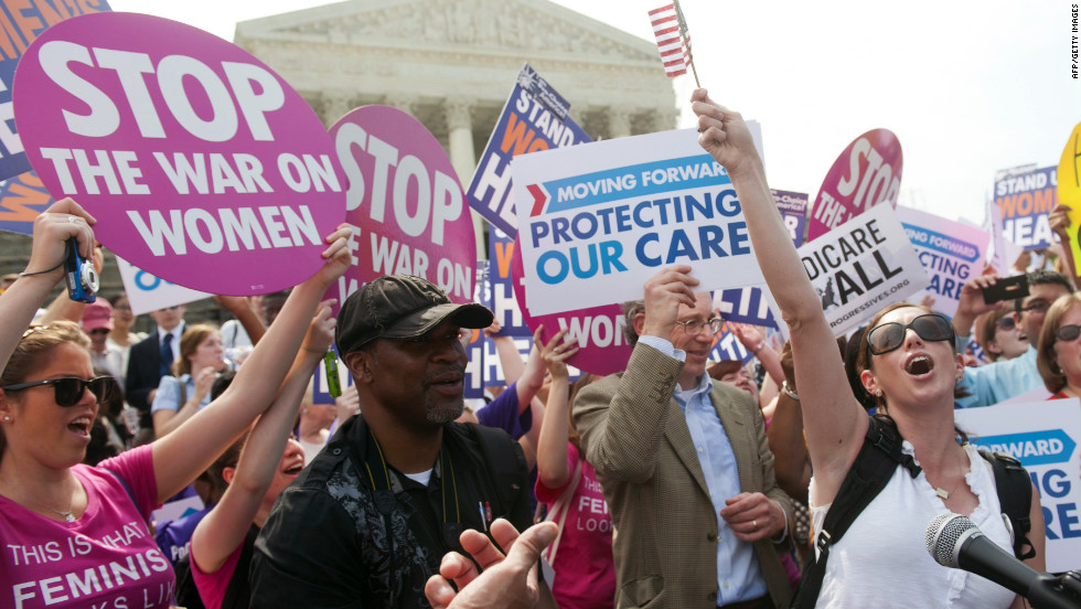 Supporters of President Barack Obama's signature health care legislation celebrate after the U.S. Supreme Court, in a 5-4 decision, upheld the constitutionality of the Affordable Healthcare Act on June 28.