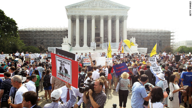 WASHINGTON, DC - JUNE 28:  Obamacare supporters and protesters gather in front of the U.S. Supreme Court to find out the ruling on the Affordable Health Act June 28, 2012 in front of the U.S. Supreme Court in Washington, DC. The Supreme Court has upheld the whole healthcare law of the Obama Administration.  (Photo by Alex Wong/Getty Images)