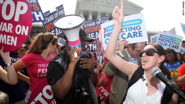 WASHINGTON, DC - JUNE 28: Local resident Angela Botlicella (R), along with other Obamacare supporters, celebrate as they respond to the Supreme Court ruling on the Affordable Health Act June 28, 2012 in front of the U.S. Supreme Court in Washington, DC. The Supreme Court has upheld the whole healthcare law of the Obama Administration. (Photo by Alex Wong/Getty Images)