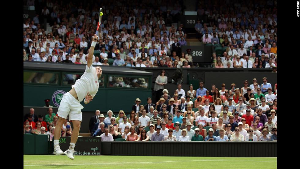Andy Murray of Great Britain serves to Ivo Karlovic of Croatia on June 28.