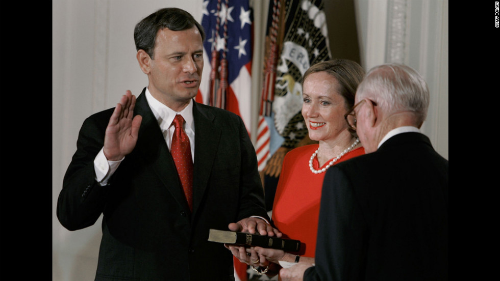As his wife Jane holds the Bible, Chief Justice John Roberts is sworn in by Associate Justice John Paul Stevens during a ceremony at the White House on September 29, 2005. Roberts became the 17th chief justice after the Senate voted 78-22 to confirm his appointment.