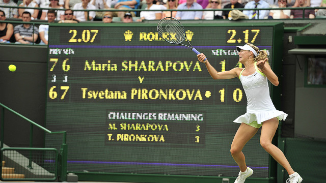 Russia's Maria Sharapova plays a forehand shot during her second round women's singles victory over Bulgaria's Tsvetana Pironkova