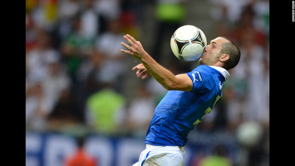 Italian defender Giorgio Chiellini heads the ball.