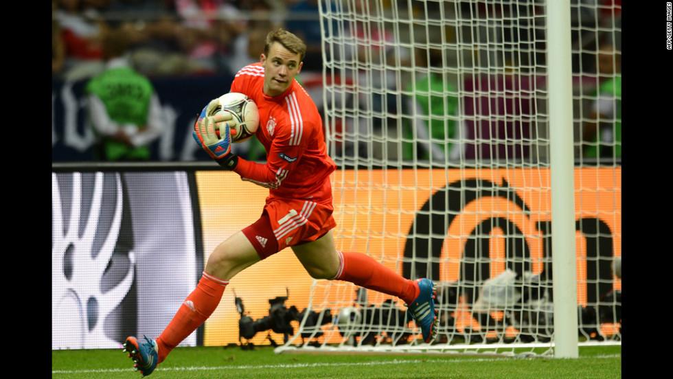 German goalkeeper Manuel Neuer grabs the ball.