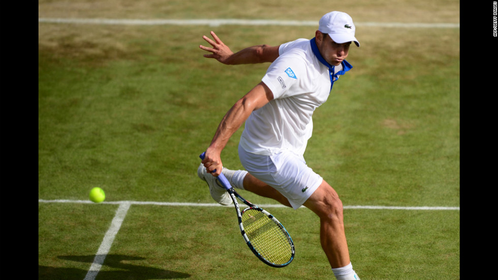 U.S. player Andy Roddick plays a backhand shot during his second-round men's singles victory over Germany's Bjorn Phau on June 28.