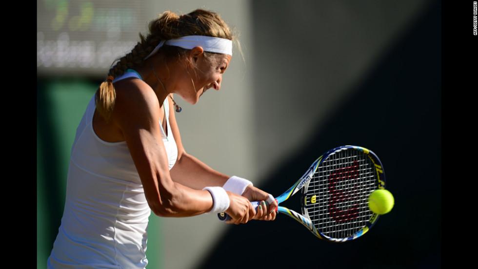 Belarus's Victoria Azarenka plays a double-handed backhand shot during her second-round women's singles victory over Switzerland's Romina Oprandi June 28.