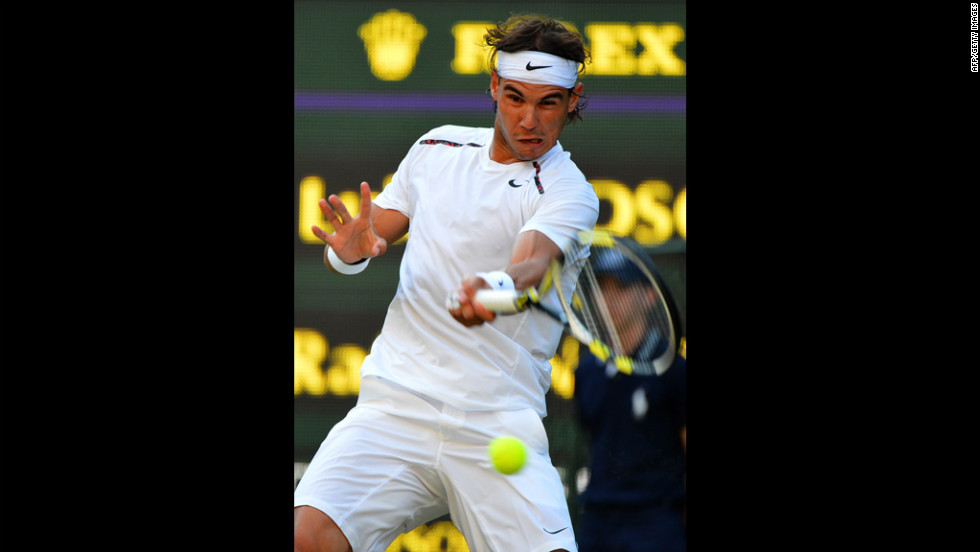 Spain's Rafael Nadal plays a forehand shot during his second-round men's singles match against Czech Republic's Lukas Rosol June 28.