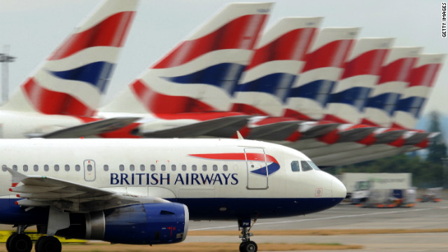 A British Airways aircraft taxis past other parked British Airways aircraft at Terminal 5 of Heathrow Airport in west London, on July 30, 2010.