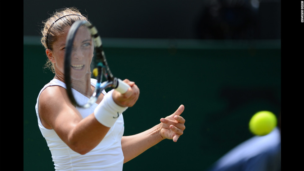 Italy's Sara Errani returns a forehand shot to Anne Keothavong of Britain on June28. Errani defeated Keothavong 6-1, 6-1.