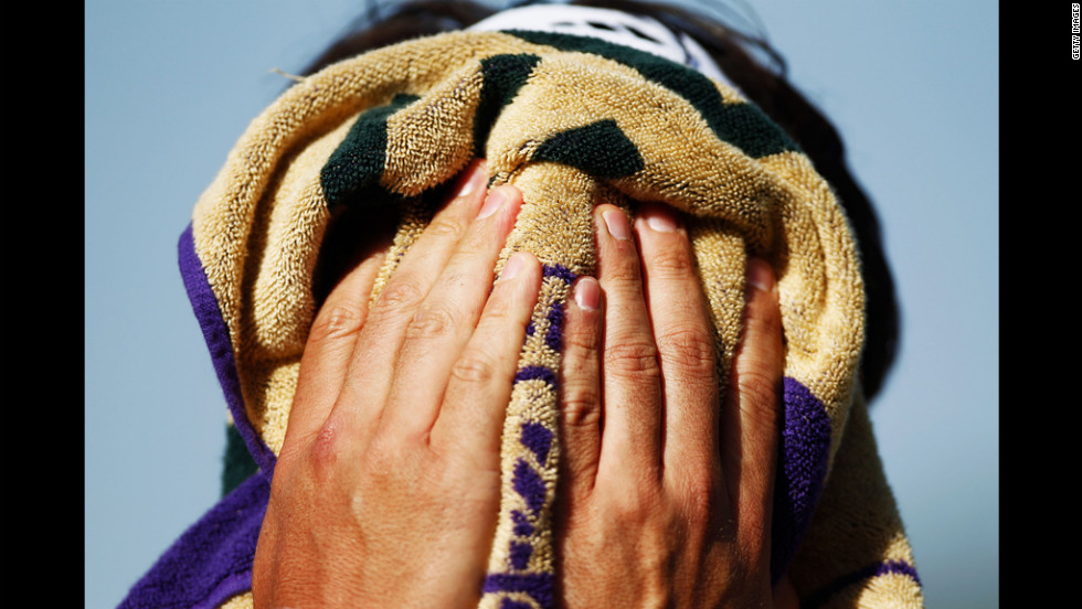 Marcos Baghdatis of Cyprus wipes his face during a match Thursday, June 28.