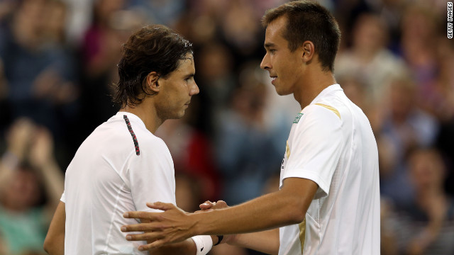 Lukas Rosol of the Czech Republic shakes hands with Rafael Nadal of Spain after defeating him during their Gentlemen's Singles second round match on day four of the Wimbledon Lawn Tennis Championships at the All England Lawn Tennis and Croquet Club on June 28, 2012 in London, England