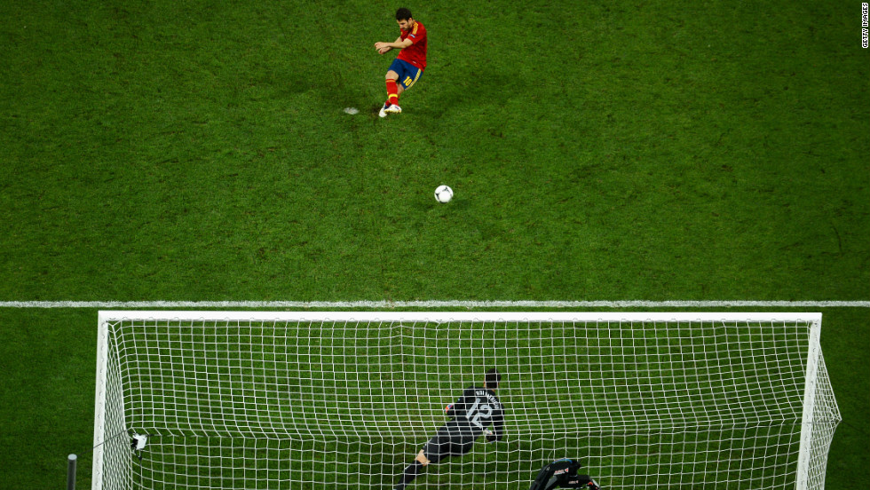Cesc Fabregas' scuffed penalty went in off the post as Spain beat Portugal in their semifinal shootout to earn a place in the final against Italy in Kiev on Sunday.