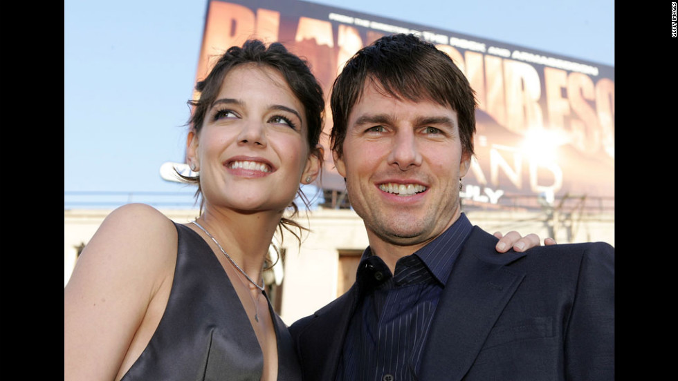 "Holmes and Cruise are all smiles at the premiere of ""Batman Begins"" in 2005."