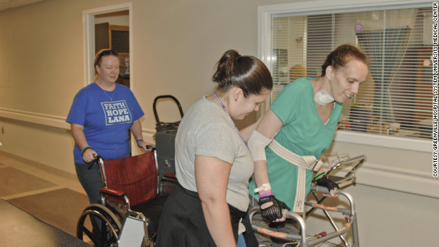Lana Kuykendall takes steps with the aid of a walker as part of her physical therapy in Greenville, South Carolina.