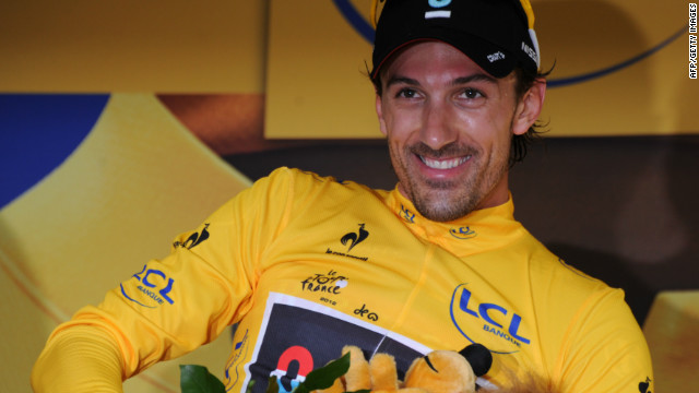 Fabian Cancellara dons the first yellow jersey of the 2012 Tour de France after his prologue victory in Liege.