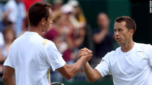 Lukas Rosol (left) shakes hands with Philipp Kohlschreiber after losing to the German in the third round at Wimbledon.
