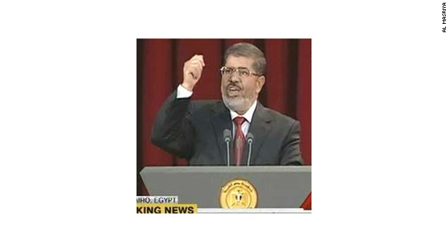 Egypt's new president, Mohamed Morsi, addresses the nation at Cairo University, shortly after being sworn in.