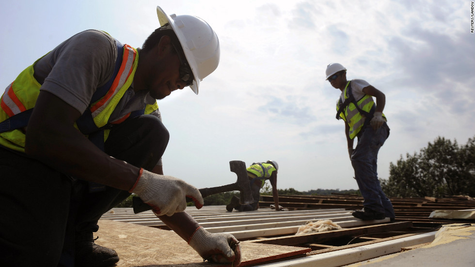 Workers brave the high heat to repair a storm-damaged roof at the Park Tanglewood apartments in Riverdale, Maryland, on Saturday.