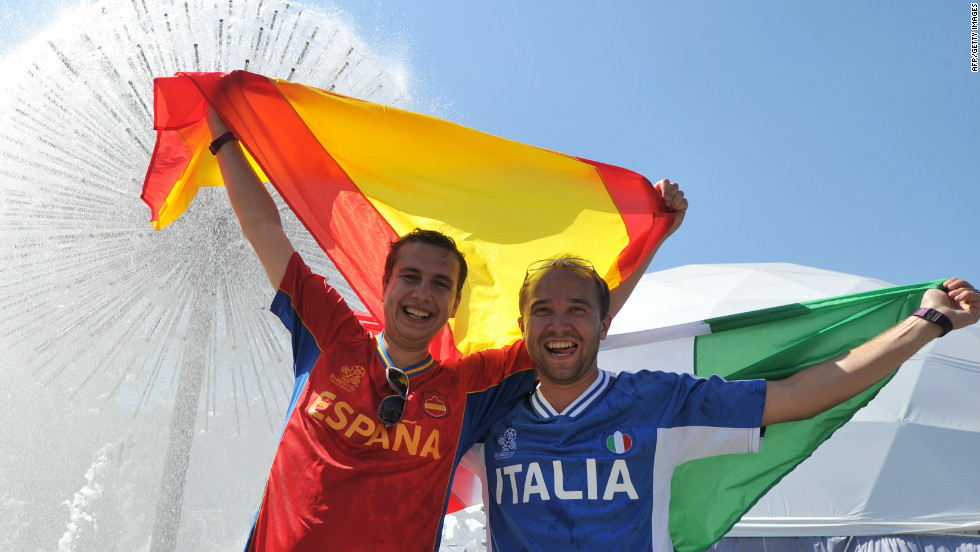 Spanish and Italian supporters mingle in Kiev's fan zone before Sunday's big game.