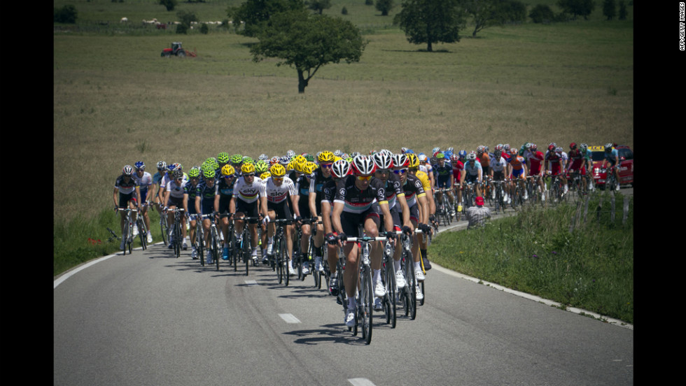 The peloton travels along a narrow road through the Belgian countryside on Sunday.