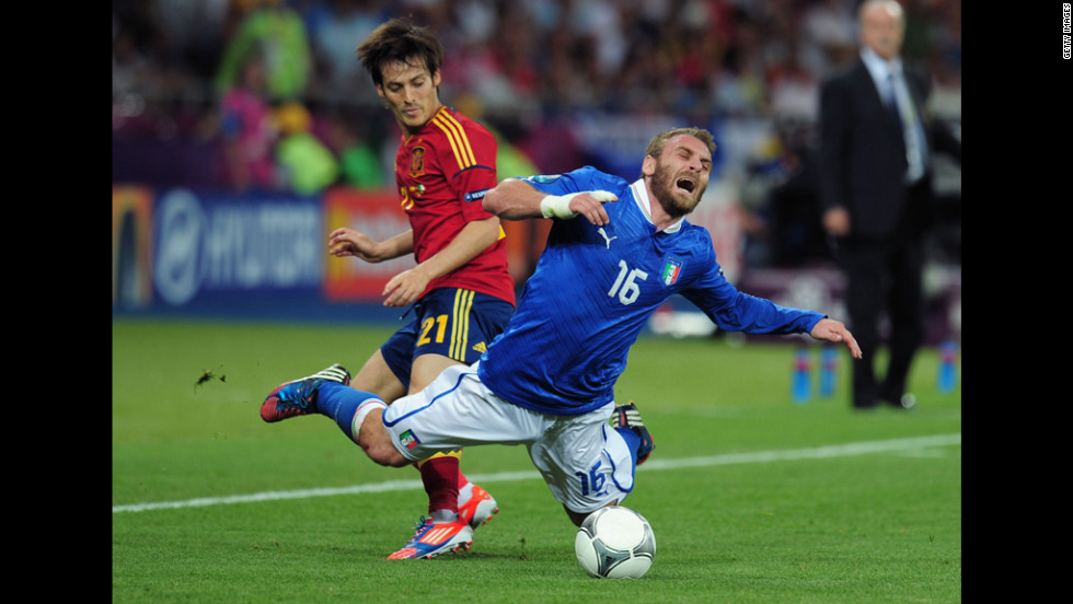 Daniele De Rossi of Italy falls to the ground Sunday after battling David Silva of Spain for the ball.