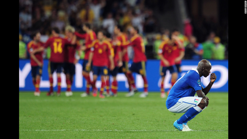 Italy's Mario Balotelli reacts to Spain's fourth and final goal in Sunday's match.