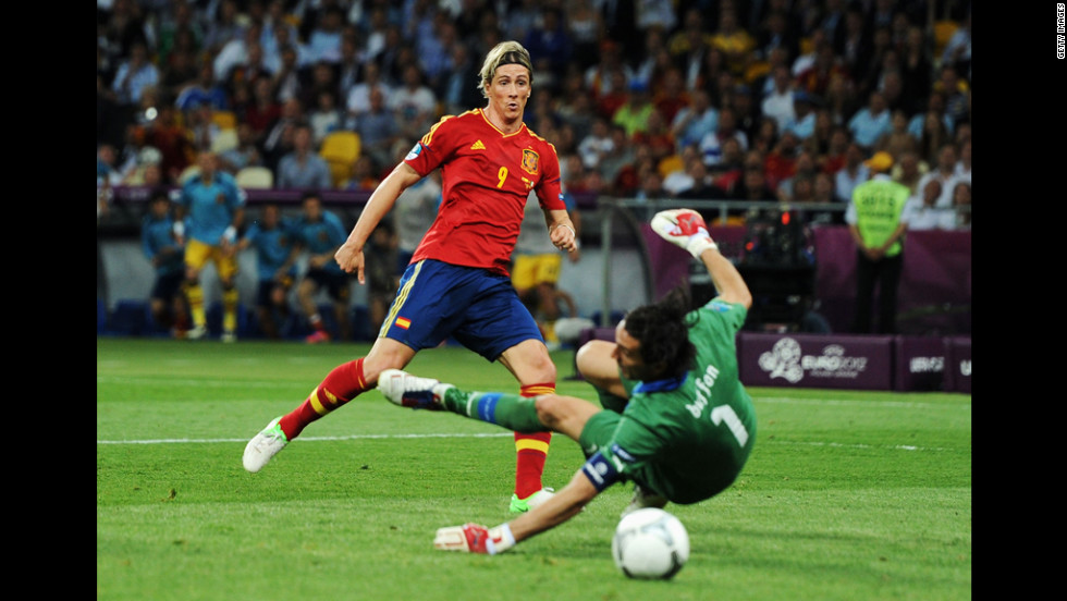 Spain's Fernando Torres nudges the ball toward the goal past Italy's Gianluigi Buffon.