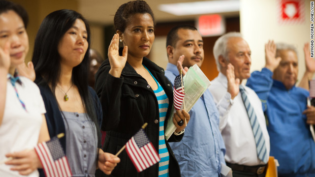 Immigrants take the Oath of Naturalization during a naturalization ceremony to officially become U.S. citizens,  in Atlanta, June 29.