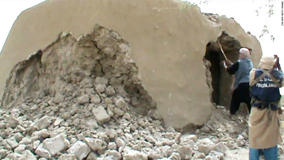 Islamists have established themselves in the northern part of Mali, where they have repeatedly targeted Timbuktu's ancient burial sites, which they regard  as idolatrous. <br />Pictured, Islamist militants destroy an ancient shrine in Timbuktu on July 1, in a still from a video.