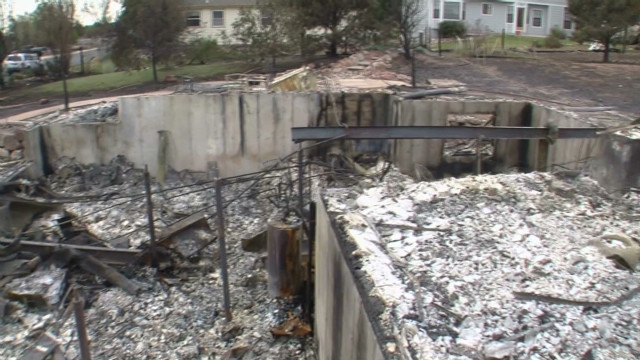 Wildfire victims tour devastated homes