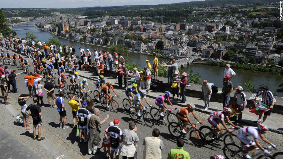 Fans cheer on riders as they climb the Cote de la Citadelle de Namur (Climb of Namur Citadel) during Stage 2, which takes place in Belgium.