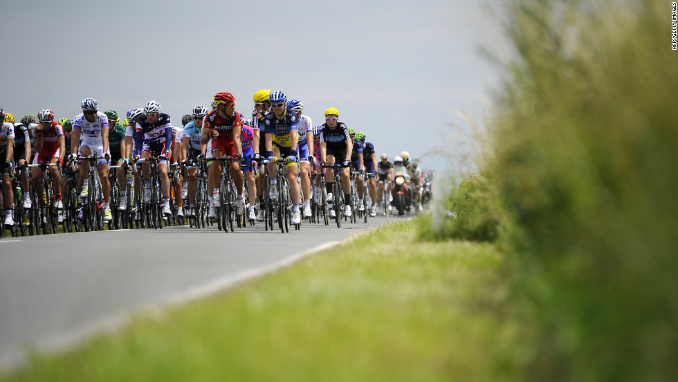 The main group of riders quickly fell several minutes behind the breakaway group as they traveled along Belgian roads Monday.