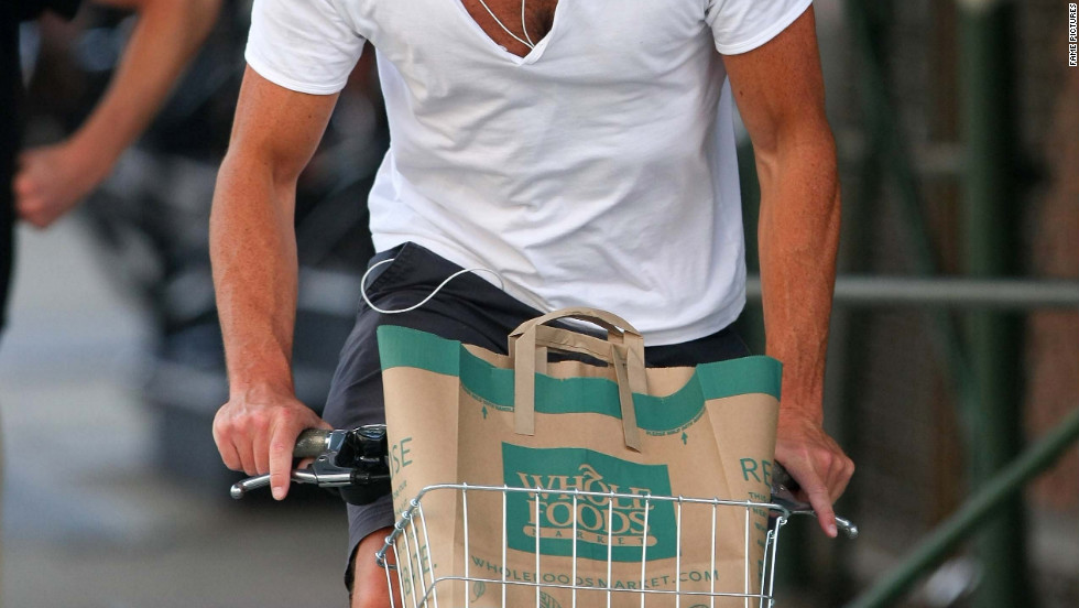 Will Arnett bikes through Tribeca in New York City.
