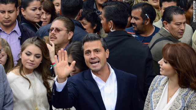The presidential candidate for Mexico's Institutional Revolutionary Party (PRI), Enrique Peña Nieto, waves after casting his vote in the presidential elections, in Atlacomulco, state of Mexico, on July 1, 2012.