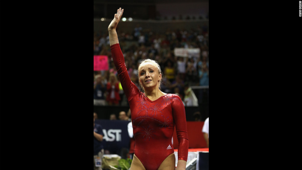 Nastia Liukin waves to the crowd after competing on the beam during Day Four of the 2012 U.S. Olympic Gymnastics Team Trials.